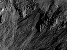 This image shows a close-up of long,<br /> narrow, sinuous gullies that scientists<br /> on NASA&#39;s Dawn mission have found on<br /> the giant asteroid Vesta.<br /> Image credit: NASA/JPL-Caltech/UCLA/<br /> MPS/DLR/IDA<br /> <a href='http://www.nasa.gov/mission_pages/dawn/multimedia/pia16490.html' class='bbc_url' title='External link' rel='nofollow external'>� Full image and caption</a>
